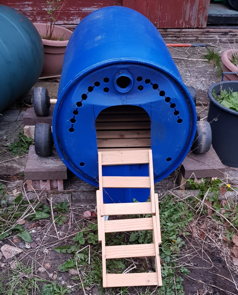 Plastic barrel chicken coop